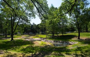 Battle Grove Restoration Project has been planned as an on-campus storm water restoration project since the early 2000s. The bowl-like field adjacent to McIver Residence Hall was a stream prior to campus development in the area and frequently flooded during periods of prolonged or heavy rain.