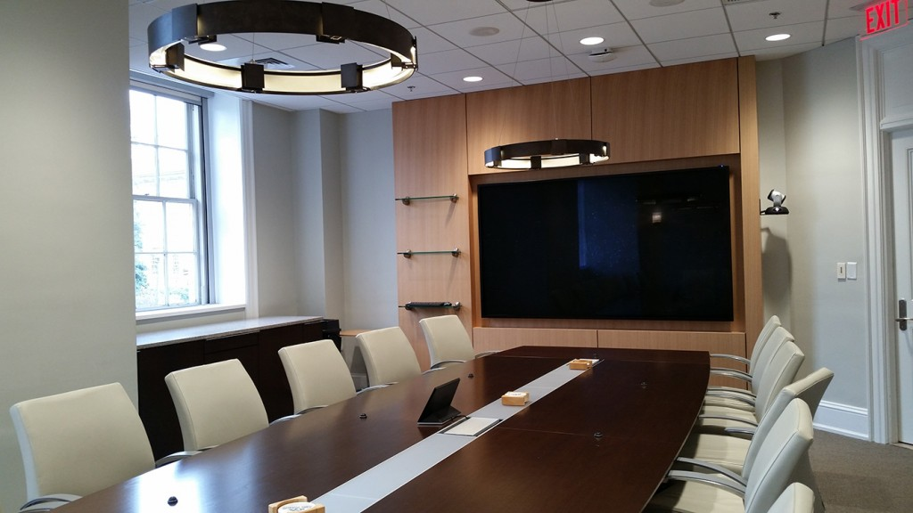 Conference room with wooden table and large flatscreen