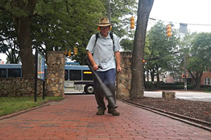 Grounds technician maintaining campus